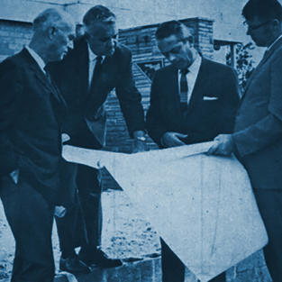 Albert O'Neall, PE, State Headquarters Building and Grounds Committee Chairman; Roland Lee, PE, Headquarters Building Finance Committee Chairman; 1969-1970 FES President Roy H. Barto, PE; and Executive Director Gene Lent check out progress on headquarters construction in 1969.